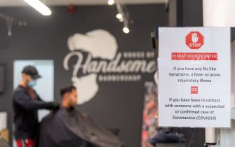 A sign is displayed at a barber shop in Wellington on May 14, 2020. - New Zealand will phase out its coronavirus lockdown over the next 10 days after successfully containing the virus, although some restrictions will remain, Prime Minister Jacinda Ardern announced on May 11. Ardern said that from May 14 shopping malls, restaurants, cinemas and playgrounds will reopen -- with the country moving to Level Two on its four-tier system. (Photo by Marty MELVILLE / AFP) (Photo by MARTY MELVILLE/AFP via Getty Images)