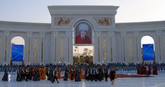 Artists take part in the opening ceremony of a new park, with a huge marble arch and a portrait of Turkmen President Gurbanguly Berdymukhamedov, in Ashgabat on June 29, 2015 as part of festivities to mark Berdymukhamedov's 58th birthday. AFP PHOTO / IGOR SASIN        (Photo credit should read IGOR SASIN/AFP via Getty Images)