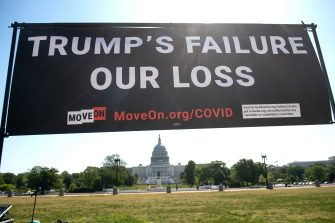 MoveOn.org stages a protest against the handling of the COVID-19 coronavirus pandemic by US President Donald Trump near the US Capitol in Washington, DC, May 13, 2020. (Photo by SAUL LOEB / AFP) (Photo by SAUL LOEB/AFP via Getty Images)