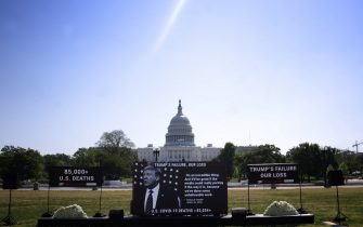 WASHINGTON, DC - MAY 13:  Video of U.S. President Donald Trump plays at at a memorial organized by the group Move On for victims of COVID-19 on the National Mall May 13, 2020 in Washington, DC. More than 80,000 Americans have died from coronavirus in the past three months.  (Photo by Win McNamee/Getty Images)