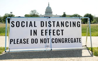 A sign urging social distancing due to COVID-19, known as coronavirus, is seen outside of the US Capitol in Washington, DC, May 13, 2020. (Photo by SAUL LOEB / AFP) (Photo by SAUL LOEB/AFP via Getty Images)