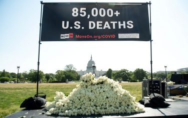 MoveOn.org stages a protest against the handling of the COVID-19 coronavirus pandemic by US President Donald Trump with signs and white roses to remember the people who died from the disease, near the US Capitol in Washington, DC, May 13, 2020. (Photo by SAUL LOEB / AFP) (Photo by SAUL LOEB/AFP via Getty Images)