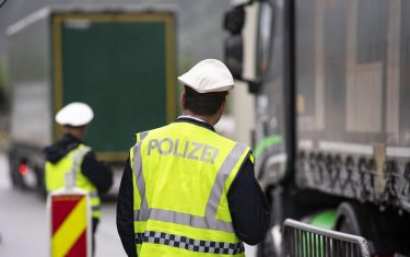 epa08418764 (FILE) - A police checkpoint slows down trucks on the A12 motorway near Ebbs, Austria, 29 July 2019 (reissued 13 May 2020). Media reports state on 13 May 2020 that Germany is planning to partially ease border controls as early as 16 May 2020, following a decision of the Cabinet. At the same time, Austria is planning to reopen the border with Germany as early as 15 June, media added.  EPA/LUKAS BARTH-TUTTAS *** Local Caption *** 55368926