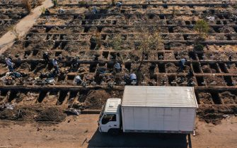 Aerial view of workers of the General Cemetery digging graves in Santiago May 14, 2020, amid the new coronavirus pandemic. - Health authorities ordered the General Cemetery of Santiago to enable over 1,700 graves under the possibility of an increase in deaths from COVID-19. (Photo by MARTIN BERNETTI / AFP) (Photo by MARTIN BERNETTI/AFP via Getty Images)