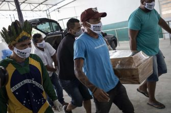 epa08422919 A group of men carry the coffin of the cacique Messias Kokama, 53, a victim of COVID-19, during his funeral at the Parque de las Tribos in the city of Manaos, Amazonas state, Brazil, 14 May 2020. The cacique Messias Kokama, considered the main indigenous leader of the city of Manaos, capital of the Brazilian state of Amazonas, died a victim of the SARS-CoV-2 coronavirus and his community burried him this Thursday without being able to pay him all the tributes with their traditional rituals.  EPA/RAPHAEL ALVES