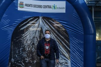 SAO GONCALO, BRAZIL - MAY 13: A man wearing a face mask walks through a disinfection tunnel at Dr. Armando Gomes de Sá Couto ER during the coronavirus (COVID-19) pandemic on May 13, 2020 in São Gonçalo, Brazil. A disinfection tunnel is installed at entrance of the ERin Ze Garoto neighborhood. According to the Brazilian Health Ministry, Brazil has 177,589 positive cases of coronavirus (COVID-19) and a total of 12.400 deaths. (Photo by Luis Alvarenga/Getty Images)