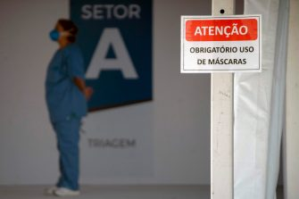 A nurse stands at the entrance of the new field hospital Parque dos Atletas -built for the treatment of the new COVID-19 coronavirus patients- in Rio de Janeiro, Brazil, on May 11, 2020. - Brazil, the hardest-hit Latin American country in the coronavirus pandemic, has surpassed 10,000 deaths, according to figures released last weekend by the Ministry of Health. (Photo by Mauro Pimentel / AFP) (Photo by MAURO PIMENTEL/AFP via Getty Images)