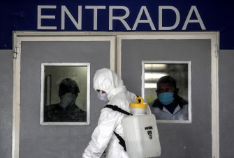 epa08406050 Members of the Brazilian army are working on the disinfection of the Pronto Medical Care Unit (UPA), in Rio de Janeiro, Brazil, 06 May 2020. Brazil has reached 114,715 cases and 7,921 deaths.  EPA/Antonio Lacerda