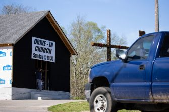 MOUNT JULIET, TN - MARCH 29:  Guests pull in for services at Global Vision Bible Church held in the parking lot on March 29, 2020 in Mount Juliet, Tennessee. Gov. Bill Lee signed an executive order that prohibits social gatherings of 10 or more in response to coronavirus (COVID-19), which is also recommended by the Centers for Disease Control and Prevention. (Photo by Brett Carlsen/Getty Images)