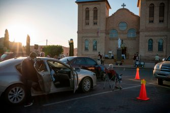 Parishioners listen to mass held outside the Basilica of San Albino on May 2, 2020 in Mesilla New Mexico, amid the coronavirus pandemic. - Catholics in many parishes around the country haven't been able to attend masses due to the outbreak of COVID-19, but Father Christopher Williams has set up drive in masses with distribution of communion using gloves and masks. (Photo by Paul Ratje / AFP) (Photo by PAUL RATJE/AFP via Getty Images)