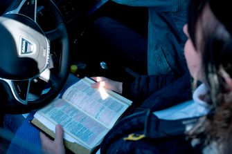 A churchgoer attends a sermon in a car at the Open Church's drive-in service in Copenhagen, Denmark, on the Palm Sunday, on April 5, 2020 amid the novel coronavirus pandemic. - The drive-in service is open to all and is an unconventional attempt to give people an opportunity to attend the mass during the corona crisis. (Photo by Claus Bech / Ritzau Scanpix / AFP) / Denmark OUT (Photo by CLAUS BECH/Ritzau Scanpix/AFP via Getty Images)