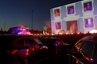 DUSSELDORF, GERMANY - APRIL 24: Rapper Alligatoah performs at the Georg Schutz drive-in cinema during the coronavirus crisis on April 23, 2020 in Dusseldorf, Germany. Drive-ins are becoming an increasingly popular venue for singers, theatre groups, and even churches to hold events while adhering to coronavirus lockdown measures. A maximum of two people are allowed to attend per vehicle and the attendees must remain in their cars. (Photo by Andreas Rentz/Getty Images)