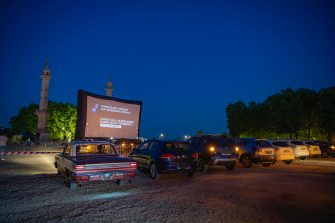 epa08426926 People arrive at the Drive-In Festival at Place des Quinconces in Bordeaux, France, France, 16 May 2020 (issued 17 May 2020). The festival opened with the movie Hippocrate of director Thomas Rilti, a tribute to caregivers who risk their lives during the coronavirus pandemic. The event runs through to 24 May 2020 before moving to Marseille.  EPA/CAROLINE BLUMBERG