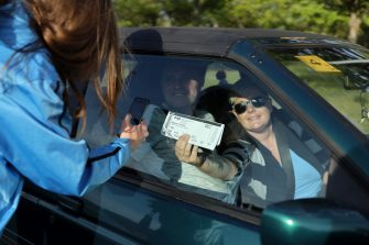 DUSSELDORF, GERMANY - APRIL 24: A security staff validates the tickets prior to rapper Alligatoah performs at the Georg Schutz drive-in cinema during the coronavirus crisis on April 23, 2020 in Dusseldorf, Germany. Drive-ins are becoming an increasingly popular venue for singers, theatre groups, and even churches to hold events while adhering to coronavirus lockdown measures. A maximum of two people are allowed to attend per vehicle and the attendees must remain in their cars. (Photo by Andreas Rentz/Getty Images)