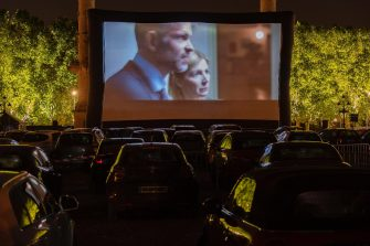 epa08426921 People watch a movie from inside their cars during the Drive-In Festival at Place des Quinconces in Bordeaux, France, France, 16 May 2020 (issued 17 May 2020). The festival opened with the movie Hippocrate of director Thomas Rilti, a tribute to caregivers who risk their lives during the coronavirus pandemic. The event runs through to 24 May 2020 before moving to Marseille.  EPA/CAROLINE BLUMBERG