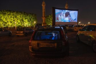 epa08426922 People watch a movie from inside their cars during the Drive-In Festival at Place des Quinconces in Bordeaux, France, France, 16 May 2020 (issued 17 May 2020). The festival opened with the movie Hippocrate of director Thomas Rilti, a tribute to caregivers who risk their lives during the coronavirus pandemic. The event runs through to 24 May 2020 before moving to Marseille.  EPA/CAROLINE BLUMBERG