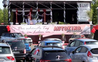 epa08402423 The mayor of Duesseldorf Thomas Geisel marries the bridal couple Janine and Philip Scholz at a drive-in cinema in Duesseldorf, Germany, 05 May 2020. On the parking lot of the exhibition area the first weddings are held in a drive-in cinema in Germany. Due to the ongoing pandemic of COVID-19 disease caused by the coronavirus SARS-CoV-2, weddings in Germany are only possible in the registry office without an audience.  EPA/FRIEDEMANN VOGEL