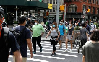 NEW YORK, NEW YORK - MAY 16: People wearing protective masks are seen as some restrictions begin to lift during the coronavirus   on May 16 2020 in New York City. COVID-19 has spread to most countries around the world, claiming over 312,000 lives and infecting over 4.7 million people. (Photo by John Lamparski/Getty Images)