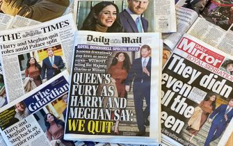 "TOPSHOT - An arrangement of UK daily newspapers photographed as an illustration in London on January 9, 2020, shows front page headlines reporting on the news that Britain's Prince Harry, Duke of Sussex and his wife Meghan, Duchess of Sussex, plan to step back as ""senior"" members of the Royal Family. - Prince Harry and his wife Meghan stunned the British monarchy on Wednesday by quitting as front-line members -- reportedly without first consulting Queen Elizabeth II. In a shock announcement, the couple said they would spend time in North America and rip up long-established relations with the press. Media reports said the Duke and Duchess of Sussex made their bombshell statement without notifying either Harry's grandmother the monarch, or his father Prince Charles. (Photo by DANIEL LEAL-OLIVAS / AFP) (Photo by DANIEL LEAL-OLIVAS/AFP via Getty Images)"