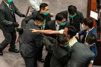 HONG KONG, CHINA - MAY 18:  Pro democracy lawmaker Eddie Chu is removed by security during a scuffle with pro Beijing lawmakers at the House Committee's election of chairpersons, presided by pro-Beijing lawmaker Chan Kin Por  at the Legislative Council on May 18, 2020 in Hong Kong, China. Pro-democracy legislators were dragged out of the chamber by security guards as the two camps fought to control the House Committee which has been at a standstill for months.(Photo by Anthony Kwan/Getty Images)