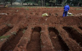 An employee is seen at the Vila Formosa cemetery, in the outskirts of Sao Paulo, Brazil on May 20, 2020, amid the new coronavirus pandemic. - Brazil has emerged as the latest flashpoint in the coronavirus pandemic. The country has registered more than 270,000 cases and nearly 18,000 deaths so far, and the increase in infections is not expected to peak until June. (Photo by NELSON ALMEIDA / AFP) (Photo by NELSON ALMEIDA/AFP via Getty Images)