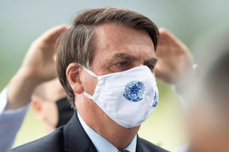 epa08433993 President of Brazil Jair Bolsonaro leaves the Palacio do Alvorada, in Brasilia, Brazil, 20 May 2020. Brazil, the third country with the most cases of COVID-19 in the world, crossed the barrier of 1,000 daily coronavirus deaths for the first time on Tuesday with 1,179 deaths and the trend is that the numbers of infected and dead will continue to grow exponentially until July, by which time awaits the peak of the incidence curve.  EPA/JOEDSON ALVES