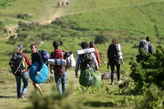 Mountain hikers walk down the Mondarrain Mount near Itxassou, southwestern France, on May 21, 2020 as France eases lockdown measures taken to curb the spread of the COVID-19 (the novel coronavirus). (Photo by GAIZKA IROZ / AFP)