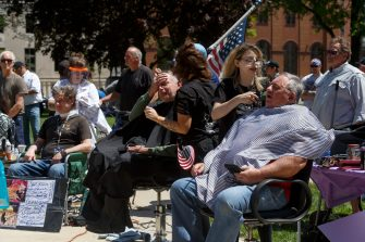LANSING, MI - MAY 20: Barbers cut hair for free near the steps of the state Capitol during Operation Haircut on May 20, 2020 in Lansing, Michigan. The event was a protest planned by the Michigan Conservative Coalition in response to an Owosso barber, Karl Manke, whose business license was taken away after he violated the stay-at-home order by reopening. The protest is part of a growing national movement against stay-at-home orders that are designed to help slow the spread of the coronavirus (COVID-19). (Photo by Elaine Cromie/Getty Images)