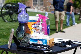 LANSING, MI - MAY 20: Disinfectant, shears and a tip jar sit next to Danielle Ashcraft's chair while she gives free haircuts near the steps of the state Capitol during Operation Haircut on May 20, 2020 in Lansing, Michigan. The event was a protest planned by the Michigan Conservative Coalition in response to an Owosso barber, Karl Manke, whose business license was taken away after he violated the stay-at-home order by reopening. The protest is part of a growing national movement against stay-at-home orders that are designed to help slow the spread of the coronavirus (COVID-19). (Photo by Elaine Cromie/Getty Images)