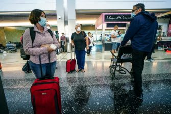SAN DIEGO, CA-MAY20:  Passengers wait to board an American Airlines flight to Charlotte, North Carolina at San Diego International Airport on May 20, 2020 in San Diego, California. Air travel is down as estimated 94 percent due to the coronavirus (COVID-19) pandemic, causing U.S. airlines to take a major financial hit with losses of $350 million to $400 million a day as nearly half of major carriers' planes sit idle. (Photo by Sandy Huffaker/Getty Images)