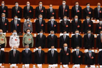 epa08436661 Delegates stand during the opening session of China's National People's Congress (NPC) at the Great Hall of the People in Beijing, China, 22 May 2020. China held the Chinese People's Political Consultative Conference (CPPCC) on 21 May and will hold the National People's Congress (NPC) on 22 May, after the two major political meetings initially planned to be held in March 2020 were postponed amid the ongoing coronavirus COVID-19 pandemic.  EPA/Ng Han Guan / POOL