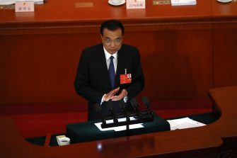 epa08436668 Chinese Premier Li Keqiang delivers the government work report during the opening session of China's National People's Congress (NPC) at the Great Hall of the People in Beijing, China, 22 May 2020. China held the Chinese People's Political Consultative Conference (CPPCC) on 21 May and will hold the National People's Congress (NPC) on 22 May, after the two major political meetings initially planned to be held in March 2020 were postponed amid the ongoing coronavirus COVID-19 pandemic.  EPA/Ng Han Guan / POOL