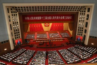 epa08436669 Chinese Premier Li Keqiang (C-L) delivers the government work report during the opening session of China's National People's Congress (NPC) at the Great Hall of the People in Beijing, China, 22 May 2020. China held the Chinese People's Political Consultative Conference (CPPCC) on 21 May and will hold the National People's Congress (NPC) on 22 May, after the two major political meetings initially planned to be held in March 2020 were postponed amid the ongoing coronavirus COVID-19 pandemic.  EPA/Ng Han Guan / POOL