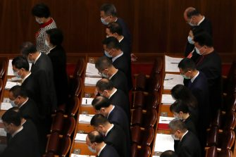 epa08436683 Delegates bow their heads during the opening session of China's National People's Congress (NPC) at the Great Hall of the People in Beijing, China, 22 May 2020. China held the Chinese People's Political Consultative Conference (CPPCC) on 21 May and will hold the National People's Congress (NPC) on 22 May, after the two major political meetings initially planned to be held in March 2020 were postponed amid the ongoing coronavirus COVID-19 pandemic.  EPA/Ng Han Guan / POOL