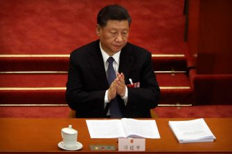 epa08436671 Chinese President Xi Jinping applauds during the opening session of China's National People's Congress (NPC) at the Great Hall of the People in Beijing, China, 22 May 2020. China held the Chinese People's Political Consultative Conference (CPPCC) on 21 May and will hold the National People's Congress (NPC) on 22 May, after the two major political meetings initially planned to be held in March 2020 were postponed amid the ongoing coronavirus COVID-19 pandemic.  EPA/Ng Han Guan / POOL