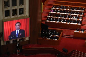 epa08436673 A video screen shows Chinese Premier Li Keqiang as he delivers the government work report during the opening session of China's National People's Congress (NPC) at the Great Hall of the People in Beijing, China, 22 May 2020. China held the Chinese People's Political Consultative Conference (CPPCC) on 21 May and will hold the National People's Congress (NPC) on 22 May, after the two major political meetings initially planned to be held in March 2020 were postponed amid the ongoing coronavirus COVID-19 pandemic.  EPA/Ng Han Guan / POOL