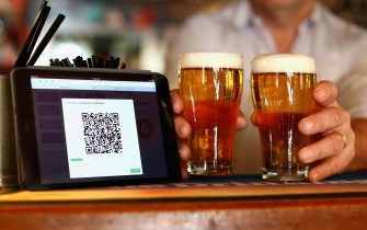 SYDNEY, AUSTRALIA - SEPTEMBER 19:  In this photo illustration, a terminal to accept payments using bitcoins is displayed on the bar at the Old Fitzroy pub on September 19, 2013 in Sydney, Australia. The Old Fitzroy pub in Sydney's eastern suburbs will accept the digital currency, Bitcoin,  as of Next Sunday.  Using a smartphone and a QR code scanning application customers will be able to purchase beer and menu items at the bar. The Old Fitzroy is the first Australian pub to accept Bitcoin payment.  (Photo by Cameron Spencer/Getty Images)