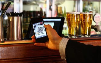 SYDNEY, AUSTRALIA - SEPTEMBER 19:  In this photo illustration, a customer scans a QR code to pay for drinks using bitcoins on September 19, 2013 in Sydney, Australia. The Old Fitzroy pub in Sydney's eastern suburbs will accept the digital currency, Bitcoin,  as of Next Sunday.  Using a smartphone and a QR code scanning application customers will be able to purchase beer and menu items at the bar. The Old Fitzroy is the first Australian pub to accept Bitcoin payment.  (Photo by Cameron Spencer/Getty Images)