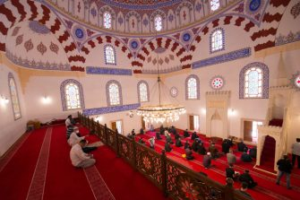 Believers maintaining physical distancing attend the last Friday prayer of the fasting month of Ramadan on May 22, 2020, in Banya Bashi Mosque in downtown Sofia. (Photo by NIKOLAY DOYCHINOV / AFP) (Photo by NIKOLAY DOYCHINOV/AFP via Getty Images)