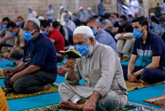 Mask-clad Palestinians attend the last Friday prayer of the fasting month of Ramadan on May 22, 2020, at al-Omari  mosque in Gaza City, after the local authorities allowed mosques to reopen amid the easing of some restrictions enacted to mitigate the spread of the novel coronavirus. (Photo by MAHMUD HAMS / AFP) (Photo by MAHMUD HAMS/AFP via Getty Images)