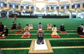 Devotees attend Friday prayers at the state mosque in Penang, ahead of the Eid al-Fitr which marks the end of the Muslim holy month of Ramadan on May 22, 2020, as social distancing is implemented during worship amid fears over the spread of the COVID-19 coronavirus. (Photo by GOH Chai Hin / AFP) (Photo by GOH CHAI HIN/AFP via Getty Images)