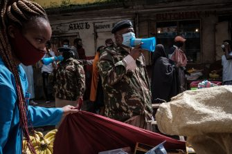 Police officers request all street vendors to close and leave to curb the spread of COVID-19 coronavirus as they emphasise the menace of the COVID-19 coronavirus in Eastleigh, a predominantly Muslim Somali neighbourhood, in Nairobi, Kenya, on April 24, 2020. (Photo by Yasuyoshi CHIBA / AFP) (Photo by YASUYOSHI CHIBA/AFP via Getty Images)