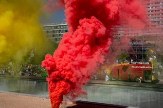 MADRID, SPAIN - MAY 23: Vox's bus reads 'Government resignation' is seen behind a red and yellow smoke flares during an in-vehicle protest against the Spanish government on May 23, 2020 in Madrid, Spain. Far right wing VOX party has called for in-vehicle protests across Spain against the Spanish government's handling of the Covid-19 pandemic. Spain has imposed some of the tightest restrictions across the world to contain the spread of the virus, but measures are now easing. Most of the Spanish population supports the lockdown according to a survey. (Photo by Pablo Blazquez Dominguez/Getty Images)