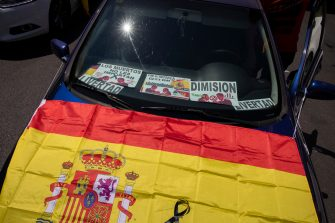 MADRID, SPAIN - MAY 23: A car displays placards against the Spanish government and a Spanish flag during an in-vehicle protest against the Spanish government on May 23, 2020 in Madrid, Spain. Far right wing VOX party has called for in-vehicle protests across Spain against the Spanish government's handling of the Covid-19 pandemic. Spain has imposed some of the tightest restrictions across the world to contain the spread of the virus, but measures are now easing. Most of the Spanish population supports the lockdown according to a survey. (Photo by Pablo Blazquez Dominguez/Getty Images)