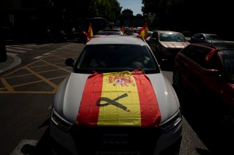 MADRID, SPAIN - MAY 23: A car a Spanish flag with a black ribbon during an in-vehicle protest against the Spanish government on May 23, 2020 in Madrid, Spain. Far right wing VOX party has called for in-vehicle protests across Spain against the Spanish government's handling of the Covid-19 pandemic. Spain has imposed some of the tightest restrictions across the world to contain the spread of the virus, but measures are now easing. Most of the Spanish population supports the lockdown according to a survey. (Photo by Pablo Blazquez Dominguez/Getty Images)