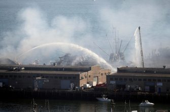 epa08440163 More than 100 San Francisco Firefighters battle a four-alarm fire on Pier 45 on Fisherman's Wharf in San Francisco, California, USA, 23 May 2020. Firefighters stationed a fireboat to protect the World War II-era SS Jeremiah O'Brien from any damage.  EPA/JOHN G. MABANGLO