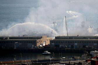 epa08440165 More than 100 San Francisco Firefighters battle a four-alarm fire on Pier 45 on Fisherman's Wharf in San Francisco, California, USA, 23 May 2020. Firefighters stationed a fireboat to protect the World War II-era SS Jeremiah O'Brien from any damage.  EPA/JOHN G. MABANGLO