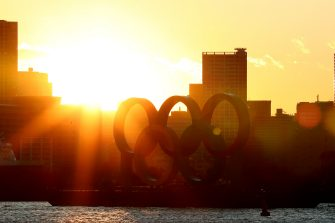 TOKYO, JAPAN - MARCH 24: The sun sets behind the Olympic rings in Odaiba marine park on March 24, 2020 in Tokyo, Japan. Although an official decision is yet to be announced, International Olympic Committee member Dick Pound has said the Tokyo 2020 Olympic Games will be postponed by one year because of the Covid-19 coronavirus after the chairman of the British Olympic Association said Great Britain would be unlikely to send a team to Tokyo this summer while Australia and Canada also said they will not compete as the global Covid-19 coronavirus pandemic that has so far seen over 380,000 infections around the world forces countries to take drastic measures to protect their populations.. (Photo by Clive Rose/Getty Images)