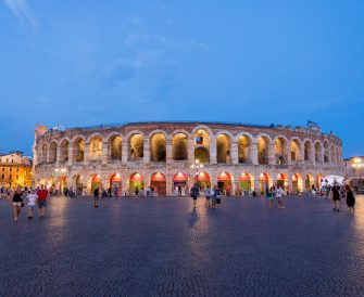 VERONA, ITALY - AUGUST 03: The Verona Arena  illuminated at night  on August 03, 2018 in Verona, Italy. The Verona Arena is a Roman amphitheatre in Piazza Bra in Verona. It is still in use today and is internationally famous for the large-scale opera performances given there. Verona is a city on the Adige river in Veneto. It is one of the main tourist destinations in northern Italy, owing to its artistic heritage and several annual fairs, shows, and operas, such as the lyrical season in the Arena, the ancient amphitheater built by the Romans.The city has been declared a World Heritage Site by UNESCO because of its urban structure and architecture. (Photo by Athanasios Gioumpasis/Getty Images)