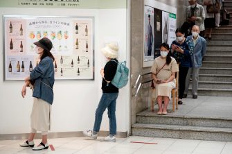 epa08442413 Customers line up before the reopening of Matsuya Ginza department store's food retailing floor after a month and a half of closure at Tokyo's Ginza shopping district, Japan, 25 May 2020. Following the decline in the COVID-19 coronavirus infections number, the government is to lift the state of emergency restrictions in Tokyo and remaining prefectures later in the day.  EPA/FRANCK ROBICHON